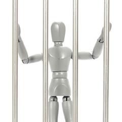 Grey mannequin in prison