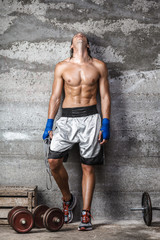 muscular boxer man standing on the wall