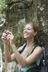 Female hiker taking photograph