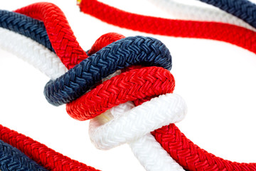 Close view of a red white and blue rope knot