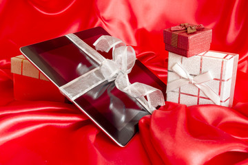 Digital tablet with christmas presents