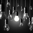 idea concept with broken bulbs and one glowing bulb - 57577803
