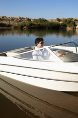 Young man in motorboat
