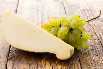 Slice of scamorza cheese from Italy