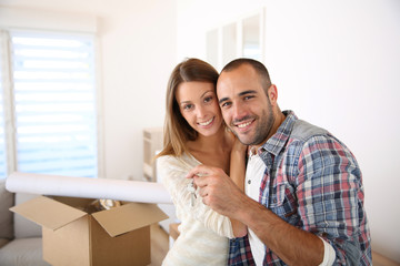 Happy couple in their new home holding key