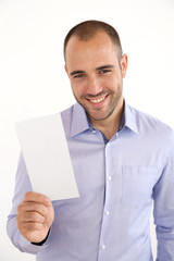 Cheerful man with blue shirt holding booklet