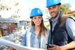 Smiling architects standing on construction site