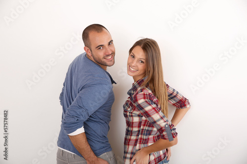 Smiling couple standing on white background