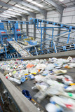 Plastic moving along conveyor belt in recycling plant
