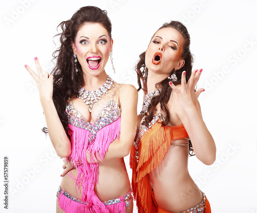 Vitality. Two Women in Oriental Stage Costumes Singing