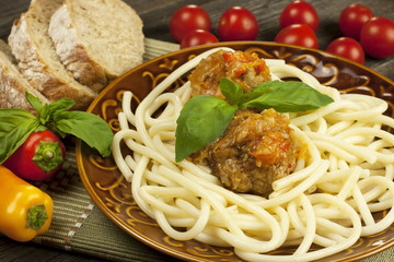 Spaghetti with meatballs on aceramic  plate