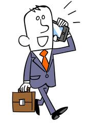歩きながらスマートフォンで会話するビジネスマン