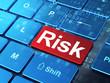 Business concept: Risk on computer keyboard background