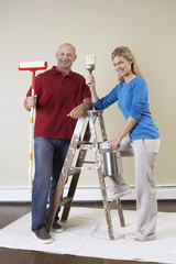 Mature couple decorating home