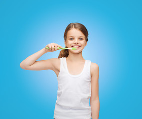 girl in blank white shirt brushing her teeth