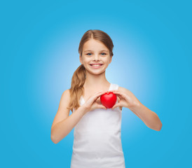 girl in blank white shirt with small red heart