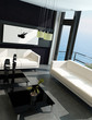 Modern living room with huge windows and black stone wall