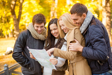 couples with tourist map in autumn park