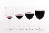 Glasses with different quantities of red wine
