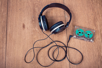 Retro compact cassette with rolls and headphones
