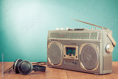 Retro cassette ghetto blaster and headphones in front mint green