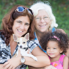 Happy hispanic family with a small dog