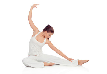 Young woman doing stretching exercises on the floor