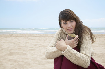 Mid-Adult Woman with Book on Beach
