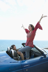 Carefree Mid-Adult Couple in Convertible