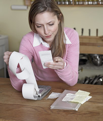 Mid-Adult Woman Examining Receipts