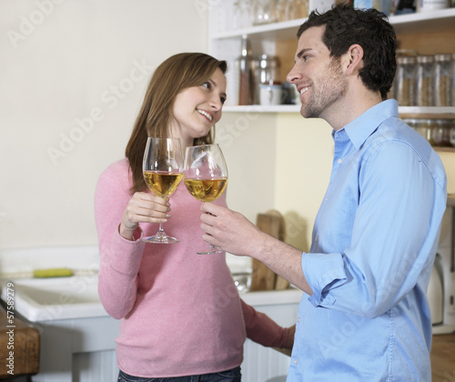 Mid-Adult Couple Toasting with White Wine