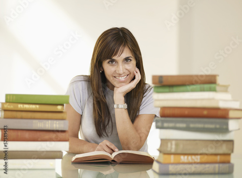 Mid-Adult Woman Reading Book
