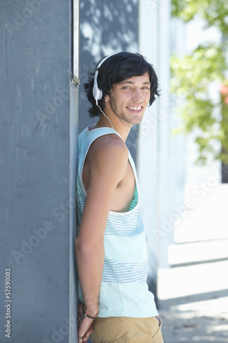 Portrait of smiling young man wearing headphones