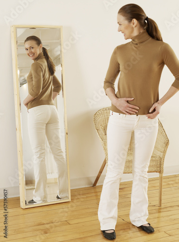 Mid-Adult Trying on Jeans