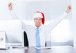 Businessman Wearing Santa Hat Using Computer