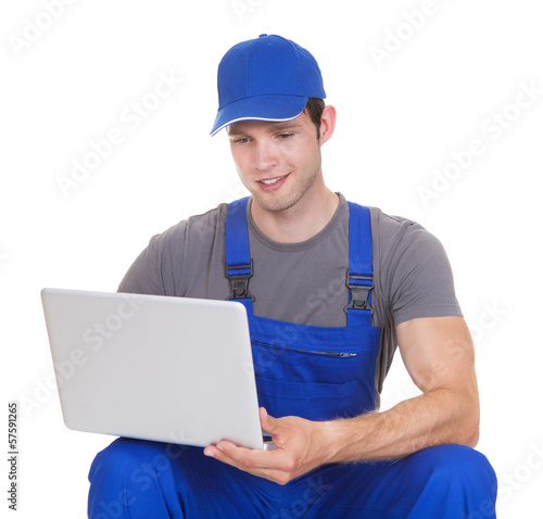 Mechanic Holding Laptop