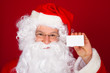 Portrait of a santa holding blank visiting card