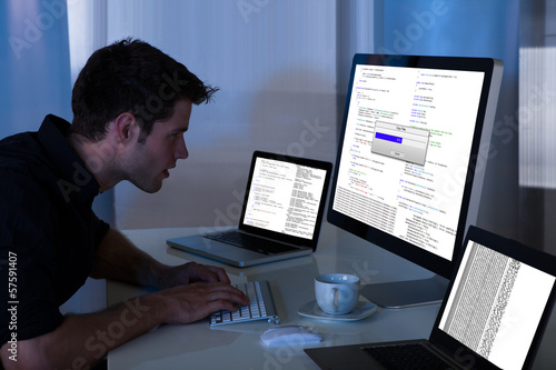 Man Working With Computer And Laptop
