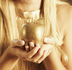 Golden Apple in Woman's Hands
