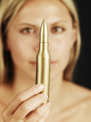 Mid-Adult Woman Holding Golden Bullet
