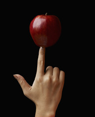 Red Apple on Woman's Finger