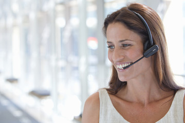 Close up of smiling businesswoman wearing headset