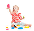 Funny little child playing with toys