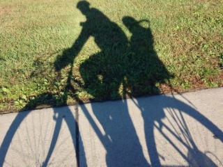 Bike with the child sit shadow
