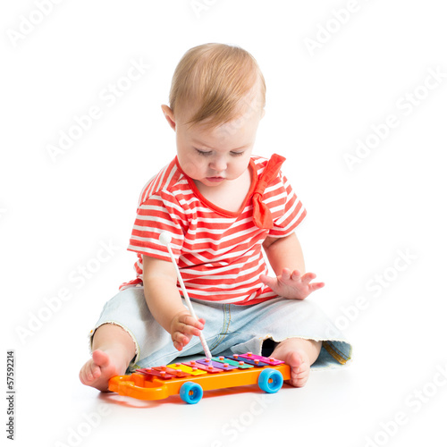 child girl playing musical toys