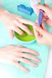 Man doing manicure in salon