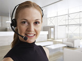Mid-Adult Woman Wearing Phone Headset