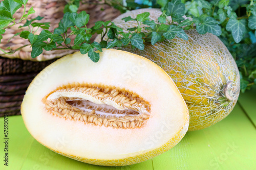 Ripe melons on wooden table close-up