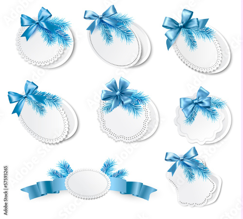 Set of christmas retro labels with  blue gift bows with ribbons.