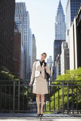 Portrait of Businesswoman by Skyscrapers
